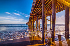 Wooden poles in Malibu pier Stock Photography