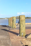 The wooden poles at the pier for security walkway. Royalty Free Stock Image