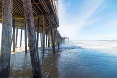 Wooden poles in Pismo Beach pier Stock Image