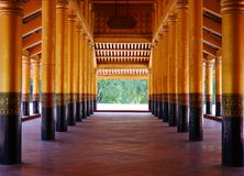 Wooden poles in a row at Mandalay Palace. In Myanmar royalty free stock image