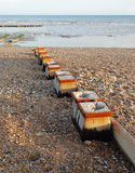Wooden poles in the sand Royalty Free Stock Photography