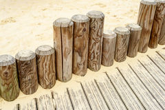 Wooden Poles and Sandpit stock images