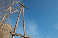 Wooden poles (support) power transmission lines. Stock Photos