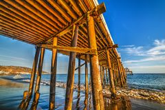 Wooden poles under Malibu pier. California, USA Stock Images