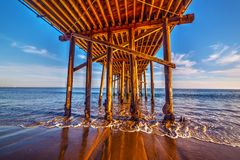 Wooden poles under Malibu pier. Los Angeles, California Stock Photography
