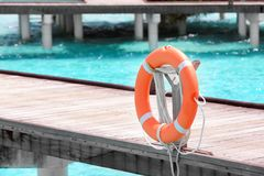 Wooden pontoon with flotation ring royalty free stock photo