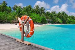 Wooden pontoon with flotation ring. At tropical resort stock photo