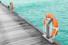 Wooden pontoon with flotation rings. At sea resort stock photography