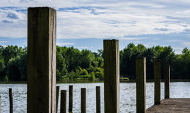 Wooden pontoon on a french pond. A wooden pontoon on a french pond Stock Photography