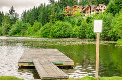 Wooden Pontoon on a Mountain Lake Stock Images