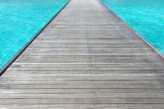 Wooden pontoon at sea resort stock photography