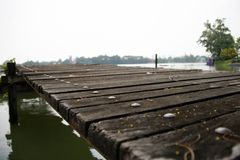 Wooden pontoon stretch into the water. wood pier on the lake it is a structure leading out from the shore into a body of waterใ. Wooden pontoon stretch into Royalty Free Stock Photos