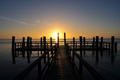 Wooden pontoon at sunset Stock Photo