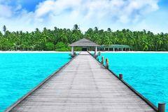 Wooden pontoon at tropical resort. On summer day stock images