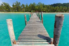 Wooden pontoon in tropical sea Royalty Free Stock Photo