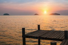 Wooden pontoons on sea coast during sunset. Nature. Wooden pontoons on sea coast during sunset Stock Images