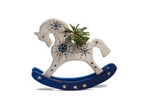 Wooden pony with spruce twig stock photos
