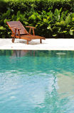 Wooden pool chair Stock Photo