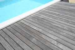 Wooden pool deck Royalty Free Stock Images