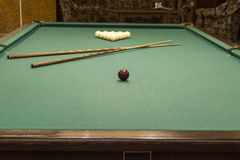 Wooden pool table with cues. Pool table prepared for the game stock photos