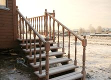 Wooden porch with carved balusters Royalty Free Stock Photo