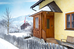 Wooden porch covered by snow in Austrian Alps Stock Photo