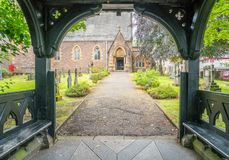 Wooden porch entrance to Saint Andrew`s Church in Fort William, Scotland. royalty free stock image