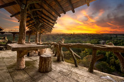 Wooden porch. At the natural view point upon the mountain in sunset time Royalty Free Stock Images