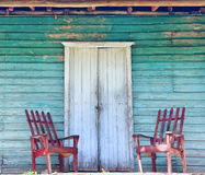 Wooden porch of the old house. And the old wooden chair. Vintage, retro style Stock Photo