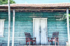 Wooden porch of the old house. And the old wooden chair. Vintage, retro style Stock Photography