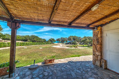 Wooden porch by the sea in Sardinia Royalty Free Stock Photo