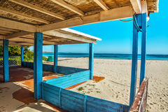 Wooden porch by the shore in Sardinia Stock Photography