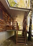 Wooden porch, staircase with steps, entrance to a wooden summer house royalty free stock image