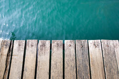 Wooden port and blue lake in thailand Royalty Free Stock Image