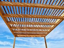 Wooden port or sun protection in front of blue sky royalty free stock photography