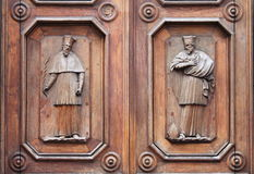 Wooden Portal with Saints Stock Photography