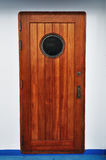 Wooden Porthole door in a ship/cruise. Royalty Free Stock Photos