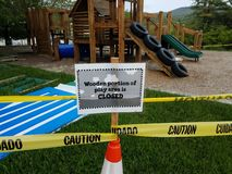Wooden portion of play area is closed sign and play structure stock images