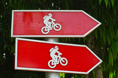 Wooden Post of Bicycle sign. Royalty Free Stock Images