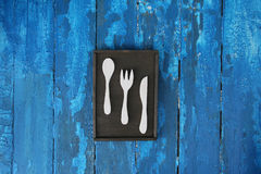 Wooden poster for kitchen with spoon, fork and knife Royalty Free Stock Photography