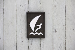 Wooden poster windsurfer, on the background of white wall Royalty Free Stock Image