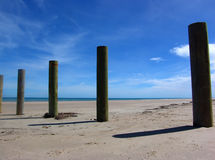 Wooden Posts. On Beach Royalty Free Stock Photos