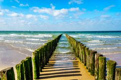 Wooden Posts of a beach erosion protection system along the beach at the town of Vlissingen in Zeeland Province. In the Netherlands royalty free stock photos