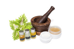 Wooden pounder with bottles of organic oils and. Cream Royalty Free Stock Photography