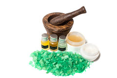 Wooden pounder with bottles of organic oils and cream isolated Stock Photos