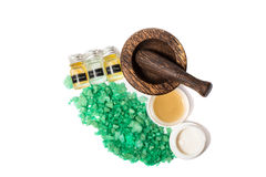 Wooden pounder with bottles of organic oils and cream isolated Royalty Free Stock Photos