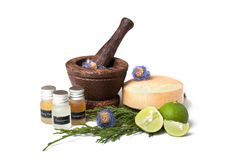 Wooden pounder with bottles of organic oils and. Soap Royalty Free Stock Photo