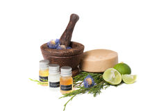 Wooden pounder with bottles of organic oils and Stock Photo