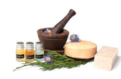Wooden pounder with bottles of organic oils and. Wooden pounder with bottles of oils and soap Stock Image