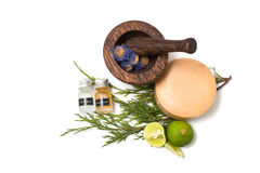 Wooden pounder with bottles of organic oils and. Soap Stock Photography